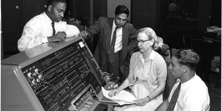 Grace Hopper, center, leads a team creating COBOL.